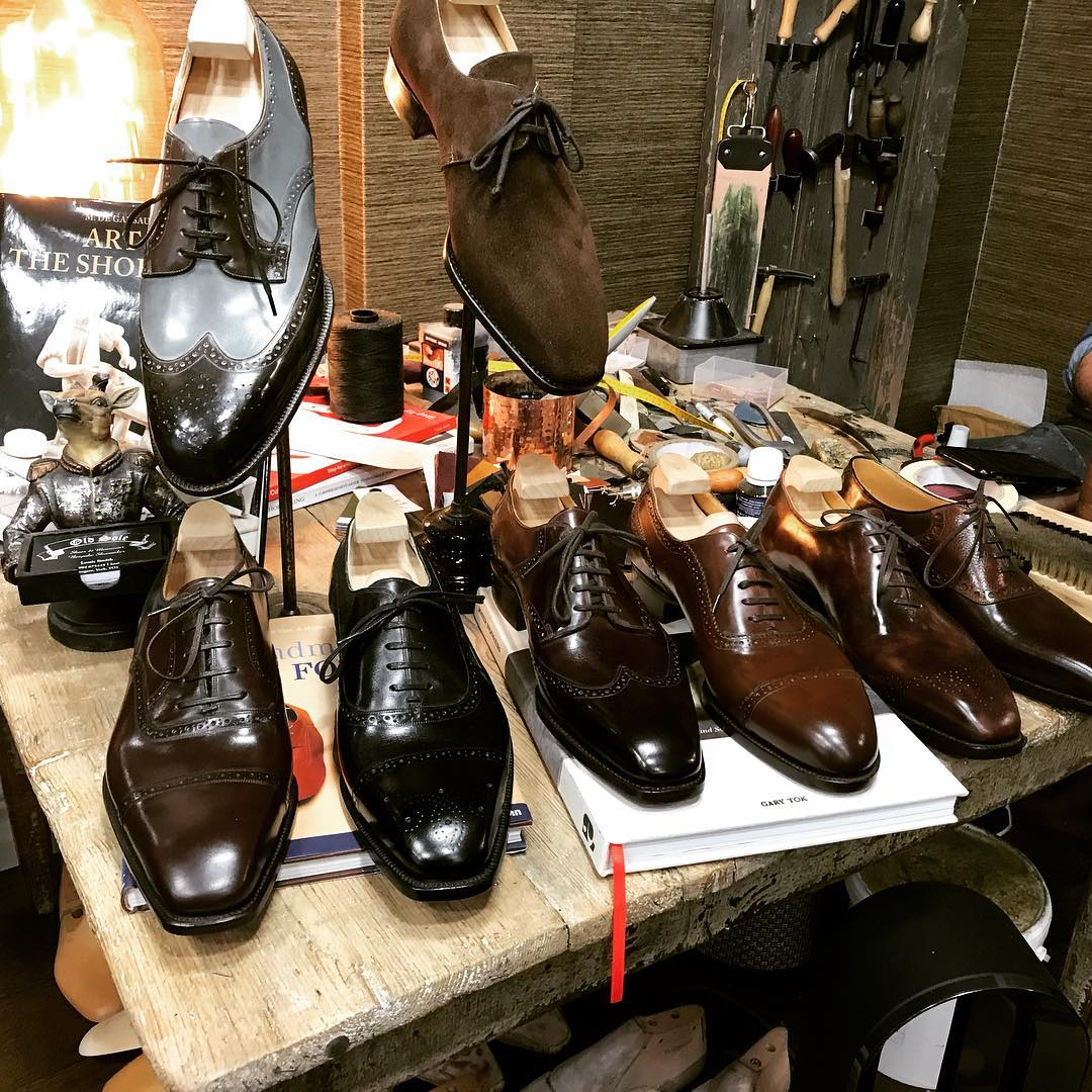 assortment of bespoke shoes on the workshop bench